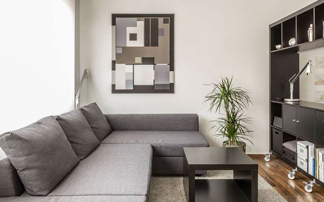 7 trucos imprescindibles para decorar salones peque os for Salones modernos para pisos pequenos