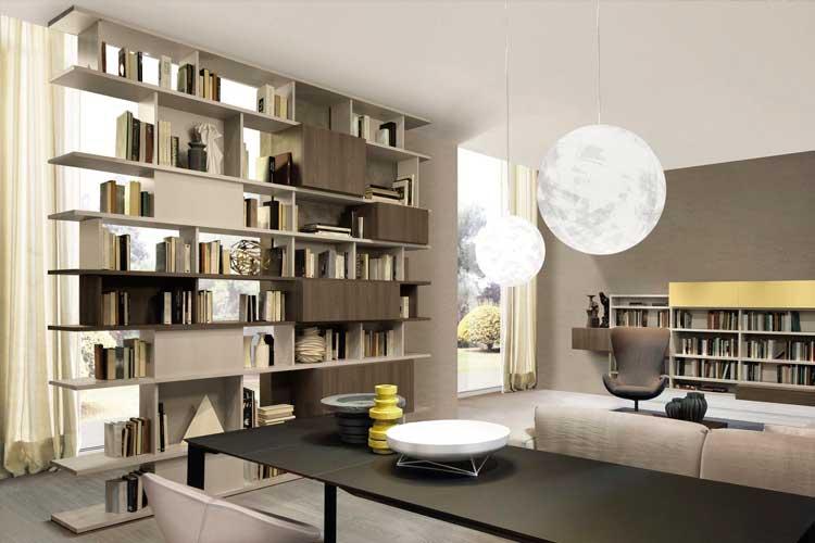 Librería de salón con aperturas a dos lados y módulos fijos